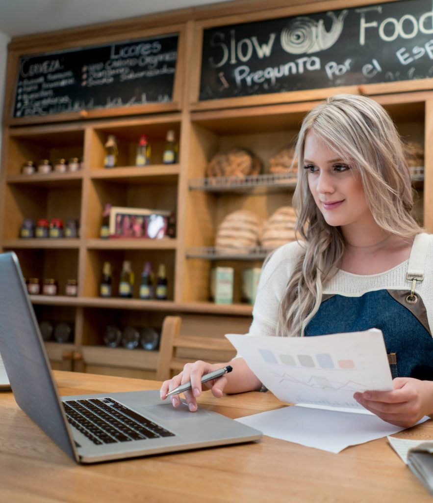 bookkeeping with paper and laptop
