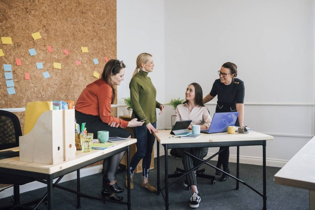 four women talking to each other