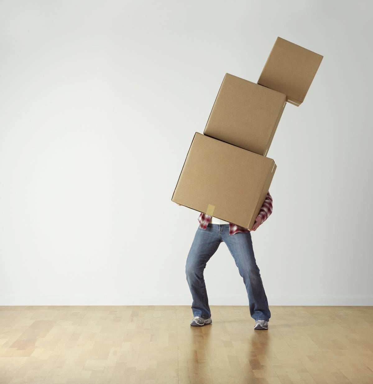 man trying to carry many boxes