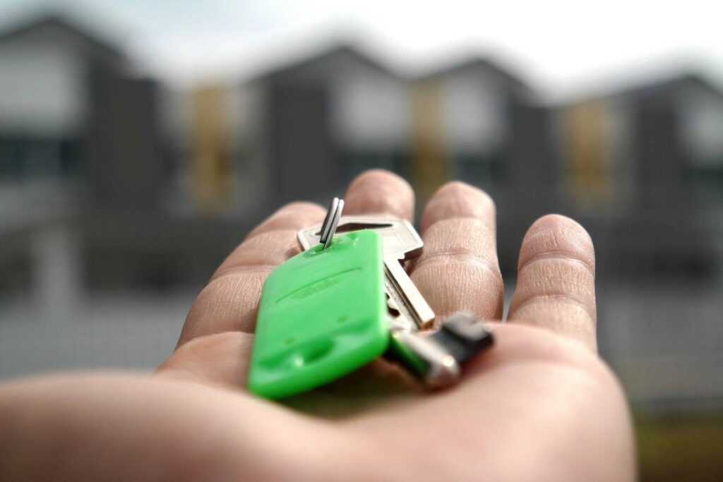 holding keys to home